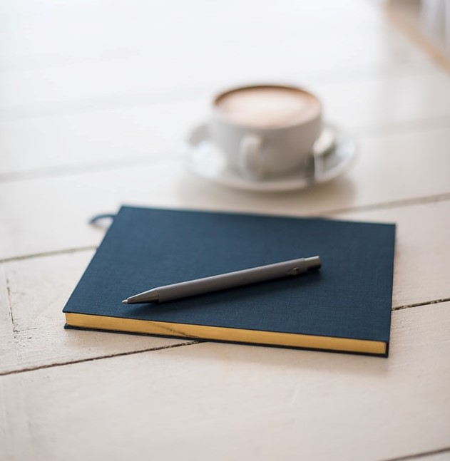 notebook and cofee cup
